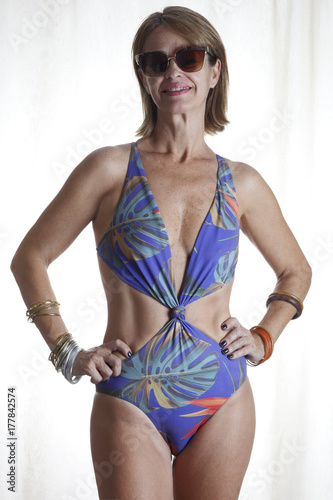 48e25951965 Approximately 50 year old woman in a beach swimsuit - Buy this stock ...