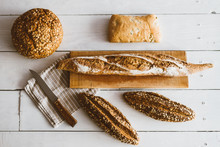 Various Types Of Bread On A Wo...