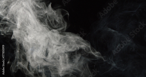 Poster Fumee Wispy tower of smoke on left side of dark background