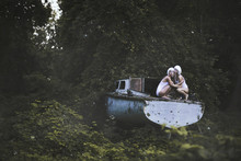 Two Women And Abandoned Boat