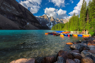 Beautiful Moraine Lake with colorful canoes in Rocky Mountains, Banff National Park, Canada.