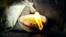 Coconut Candle In Hindu Temple...