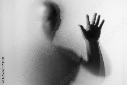 Fototapety, obrazy: Shadow blur of horror man.Dangerous man behind the frosted glass.Mystery man.Black and white picture.Blur picture.Add effects noise and grain.Halloween.Halloween.