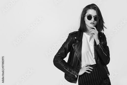 Fotografie, Obraz  Young beautiful woman in a black jacket. Black and white image