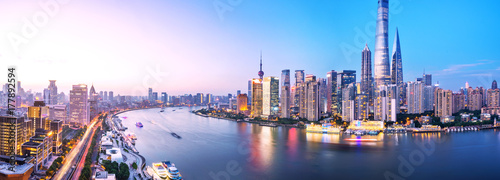Canvas Prints Shanghai modern buildings near water at twilight