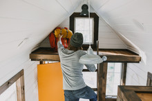 Guy Reaching In Tiny House