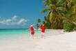 happy loving couple run play on tropical beach