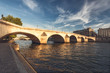 Bridge over river Seine in Paris, France at daytime viewed from a quay. Travel and architectural background. Romantic cityscape.
