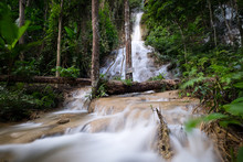 Pu Kaeng Waterfall The Large Waterfall Amid Virgin Jungle With Water Cascading Down Limestone In Chiang Rai Province Of Thailand.