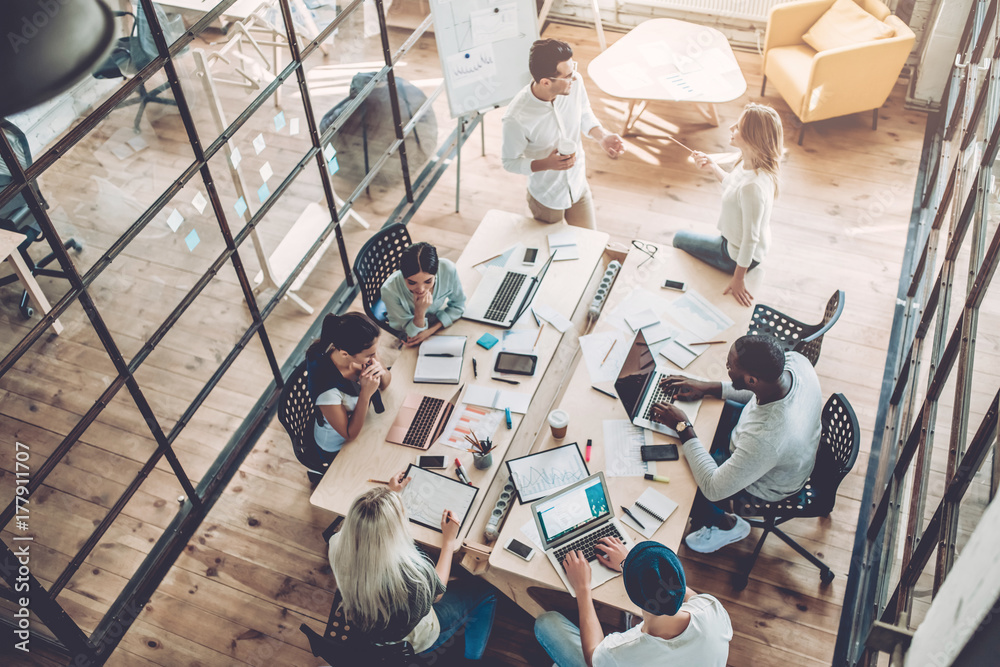 Fototapeta Young people work in modern office