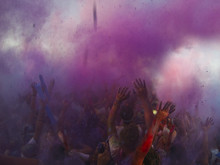 Crowd Throwing Holi Powder In The Air