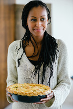 Woman Serving Apple Pie For Th...