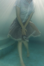 Woman Dancing In The Pool