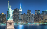 Fototapeta Nowy York - The Statue of Liberty with cityscape in Manhattan at night, New York City, USA