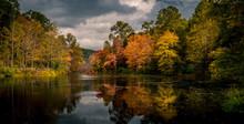 Vibrant Autumn Foliage Reflected In Swartswood Lake At Swartswood Lake State Park, Stillwater, New Jersey