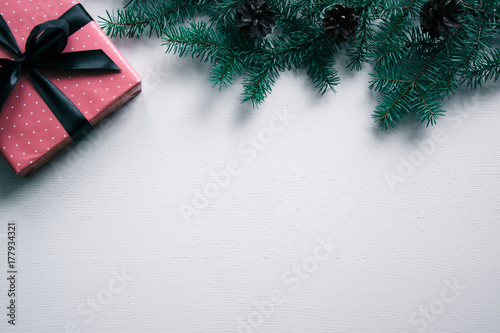 Fototapeta New year's background on a white desk decorated with toys, presents, Christmas tree, candles. Bright colored background symbolizes the new year celebration. Great useful template to wright words down. obraz na płótnie