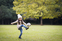 Little Girl Kicking A Soccer B...