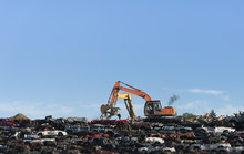 Excavators Stacking Cars For S...