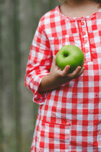 Young Girl Holding Green Apple