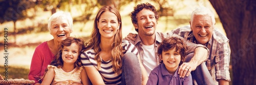 Obraz Portrait of smiling family having picnic - fototapety do salonu
