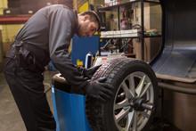 Auto Mechanic Balancing Car Ti...
