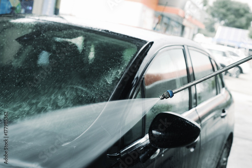 someone washing a car in a carwash © nito