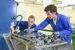 Leinwanddruck Bild - Man and woman working with sheet of glass