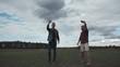 Two men taking selfie on background of flying plane.