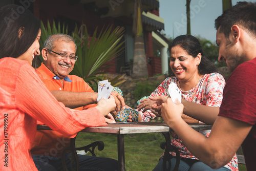 Indian family playing cards - Happy indian family of four