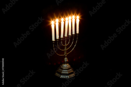 Photo  Ancient ritual candle menorah on a black background