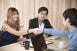 business woman and man shaking hands to accept business agreemen