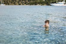 Boy In The Blue Sea With The S...
