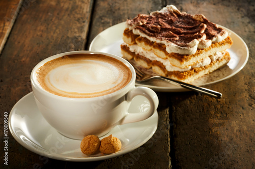 Fotografie, Obraz  Cup of milk coffee with piece of cake