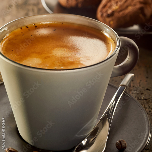 Fotografie, Obraz  Cup of crema coffee on table in close up view
