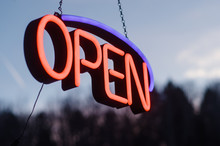 Neon Open Sign Hanging Outside...