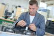 Man repairing gas hob