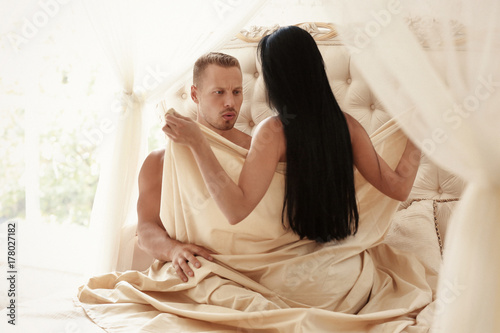 Valokuva  Sexy young couple on bed