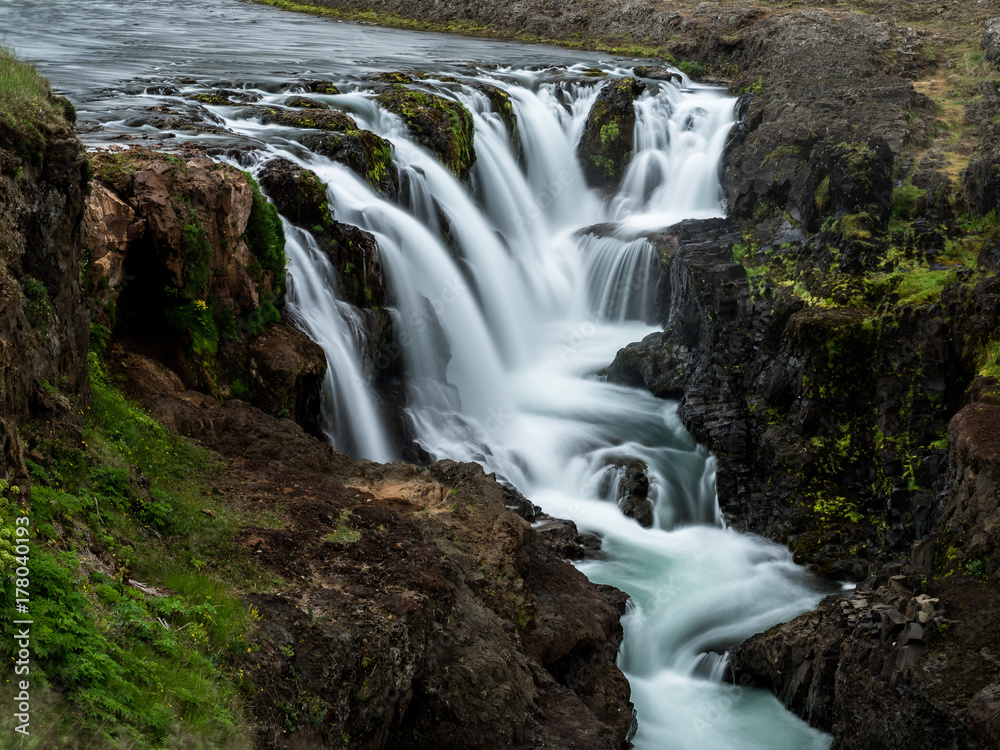 Small waterfalls in a river in Northern Iceland