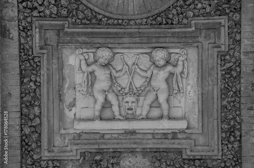 Fotografie, Obraz Ancient sculpture paintings on a fragment of the wall in the Villa Doria-Pamphil