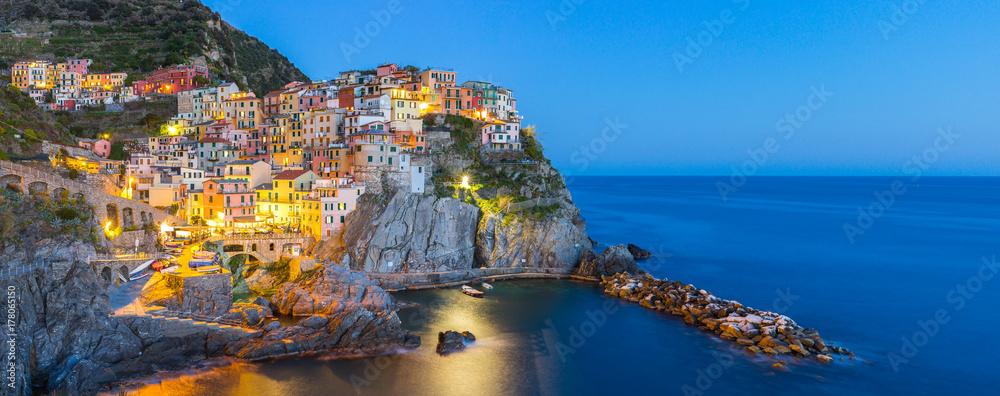 Fototapeta Manarola village one of Cinque Terre at night in La Spezia, Italy