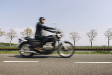 Blurry Image Of A Rider Or A M...