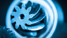 Beautiful Close-up Of Steel Gearwheel. Abstract Industrial Background With Cogwheels In Blue Color.