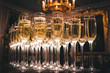 canvas print picture - A lot of glasses of champagne in a luxurious atmosphere. Stylish, toned photo. Secular reception, new year, wedding