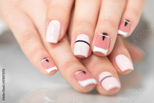 Poster Manicure Beautiful female hands with a fashionable manicure. Geometric design of nails. Photo closeup