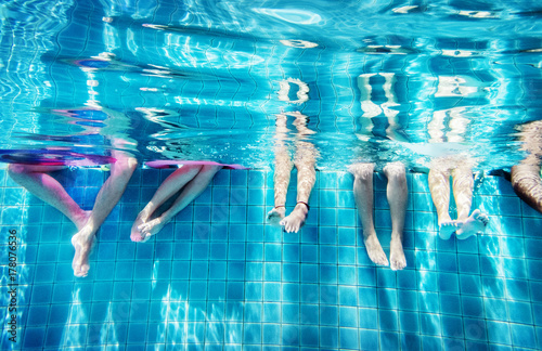 Foto  Group of people legs underwater