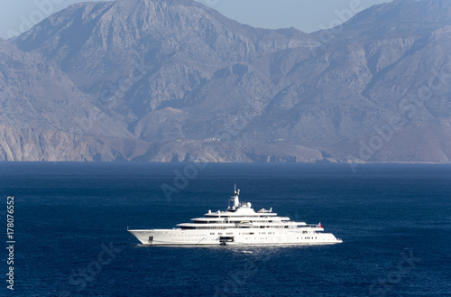 A super yacht at anchor on the Gulf of Mirabello off the Cretan town of Agios Nikolaos, Crete, Greece, October 2017