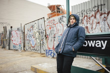 Winter Portrait Of A Young Man By A Subway Station In Brooklyn