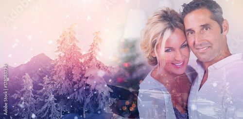 Spoed Foto op Canvas Wit Composite image of couple embracing at christmas