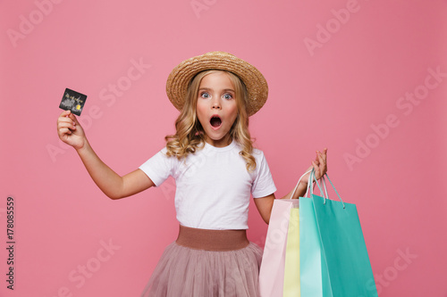 Portrait of a shocked little girl in hat and skirt Canvas-taulu