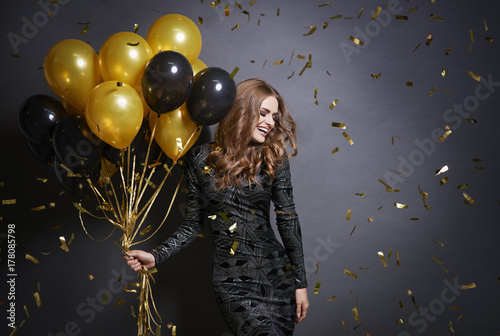 Fotografie, Obraz  Joyful woman with bunch of balloons